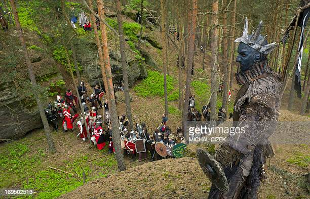 Fans dressed as goblins and wargs characters of the Tolkien classic The Hobbit prepare for the reenactment of a battle in a forest near the village...
