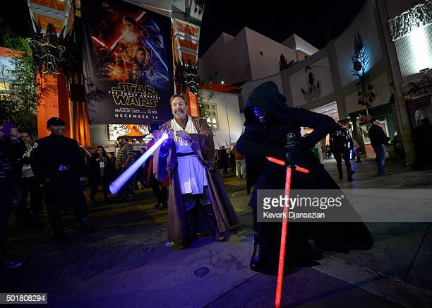 Fans dressed as ObiWan Kenobi and Kylo Ren are seen during the opening night of Walt Disney Pictures and Lucasfilm's Star Wars The Force Awakens at...