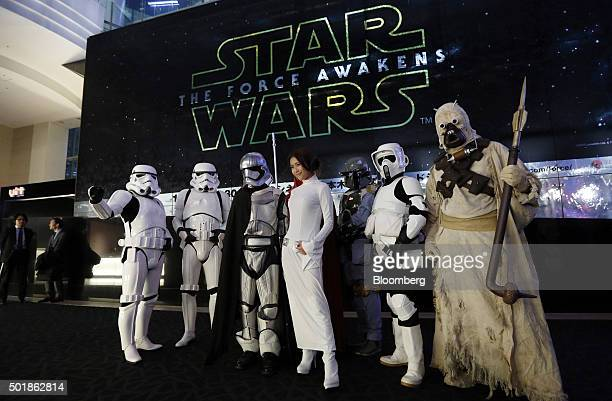 Fans dressed as Star Wars characters pose for a photograph ahead of the first public screening of Walt Disney Co's Star Wars The Force Awakens at...