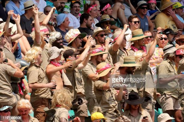 Fans dressed as Steve Irwin cheer during the first day of the third cricket Test match between Australia and New Zealand at the Sydney Cricket Ground...