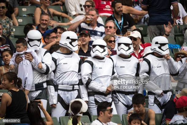 Fans dressed as Stormtroopers from the Star Wars films attend the Hong Kong Rugby Sevens tournament on April 9 2017 / AFP PHOTO / Dale DE LA REY