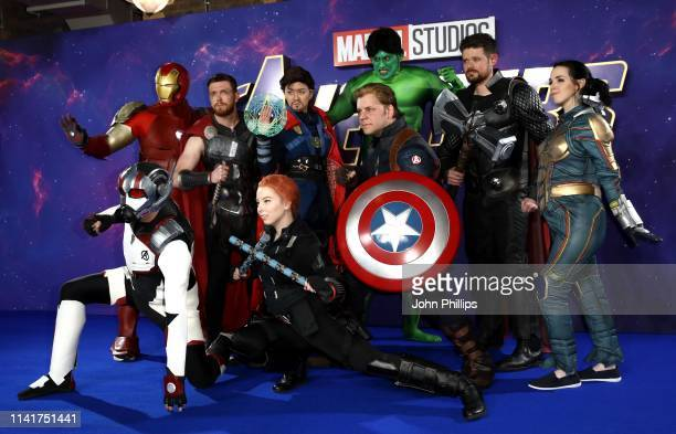 Fans dressed as superheroes attend the Avengers Endgame UK Fan Event at the Picturehouse Central on April 10 2019 in London England
