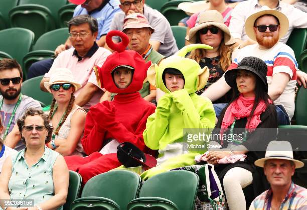 Fans dressed as Teletubbies watch as Katie Boulter of Great Britain plays Naomi Osaka of Japan during their Ladies' Singles second round match on day...