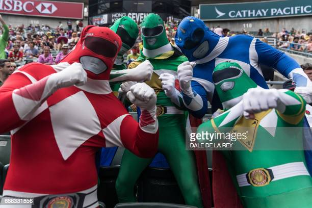 Fans dressed as the Power Rangers pose for a photograph during the Hong Kong Rugby Sevens tournament on April 9 2017 / AFP PHOTO / DALE DE LA REY