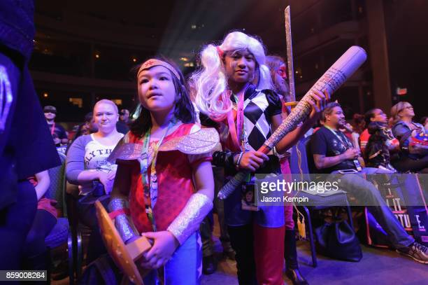 Fans dressed as Wonder Woman and Harley Quinn attend the Cartoon Network Costume Ball during New York Comic Con 2017 JK at Hammerstein Ballroom on...