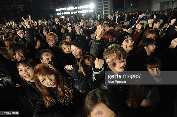 Fans dressed as Zombies attend the world premiere of 'Resident Evil The Final Chapter' at the Roppongi Hills on December 13 2016 in Tokyo Japan