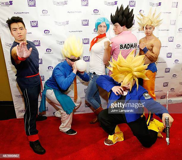 Fans dressed in character costume pose during the 'Dragon Ball Z Resurrection 'F'' New York premiere at AMC Empire 25 theater on August 3 2015 in New...