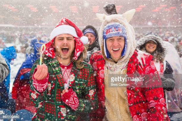 Fans dressed in Christmas themed outfits cheer during the first quarter of the game between the Buffalo Bills and the Indianapolis Colts at New Era...