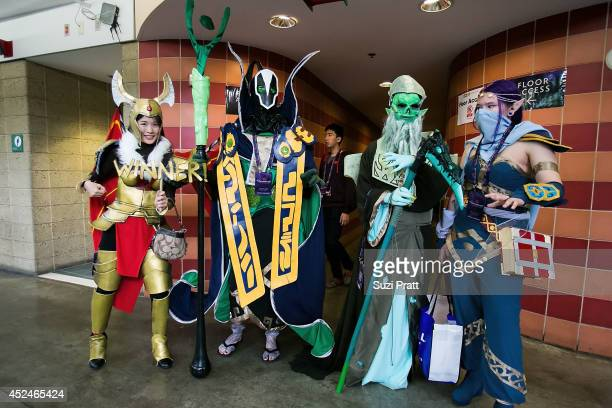 Fans dressed in cosplay pose for a photo at The International DOTA 2 Championships on July 20 2014 in Seattle Washington