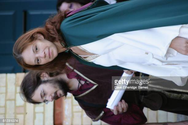 Fans dressed in 'middle earth' costumes arrive at The Fellowship Festival 2004 aimed at J R R Tolkien fans at Alexandra Palace on August 28 2004 in...
