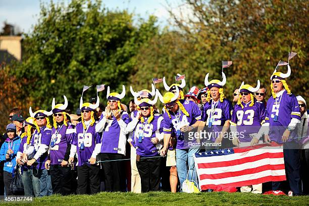 Fans dressed in Minnesota Vikings jerseys watch the golf during the Morning Fourballs of the 2014 Ryder Cup on the PGA Centenary course at the...