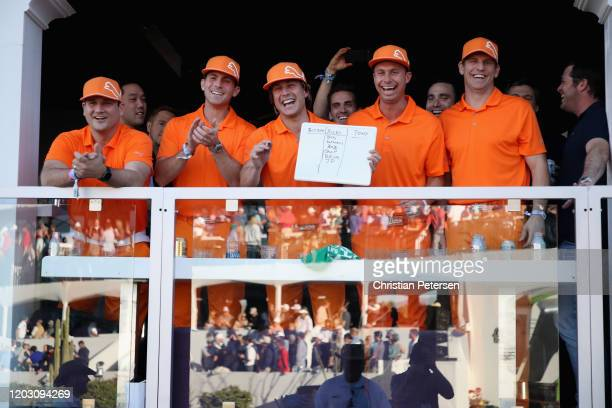 Fans dressed like Rickie Fowler a reacts on the 16th hole during the first round of the Waste Management Open at TPC Scottsdale on January 30, 2020...