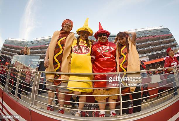 Fans dressed up as hot dogs mustard and ketchup looks on from the stands during an NFL football game between the Seattle Seahawks and San Francisco...