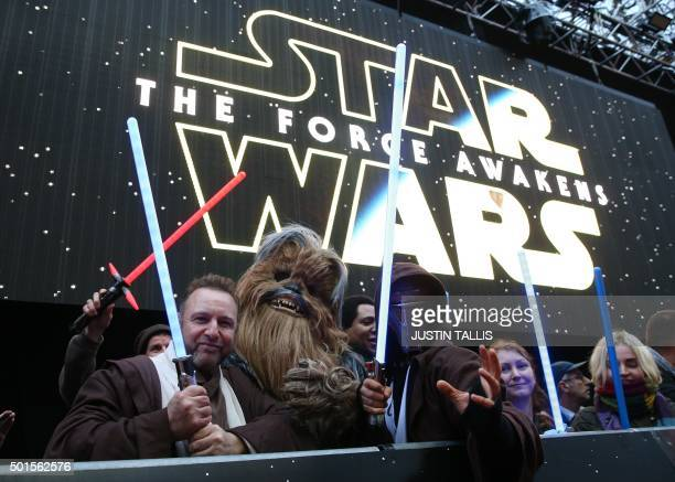TOPSHOT Fans dressed up as Star Wars character pose ahead of the European Premiere of 'Star Wars The Force Awakens' in central London on December 16...