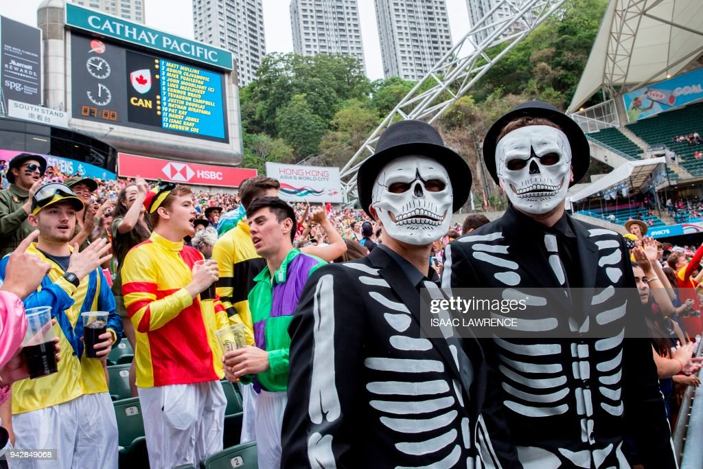 Fans dressed up in costumes attend the rugby tournament of the Hong Kong Sevens at Hong Kong Stadium on the second day on April 7, 2018. /