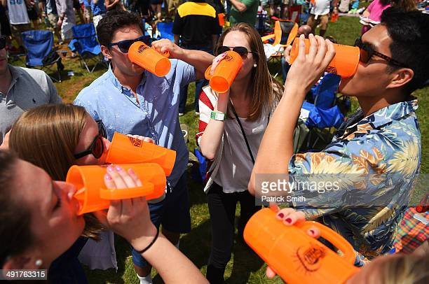 Fans drink in the infield prior to the 139th running of the Preakness Stakes at Pimlico Race Course on May 17 2014 in Baltimore Maryland
