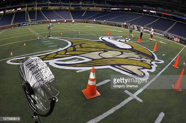Fans dry new logos painted on the field prior to the Minnesota Vikings playing the New York Giants at Ford Field on December 13 2010 in Detroit...