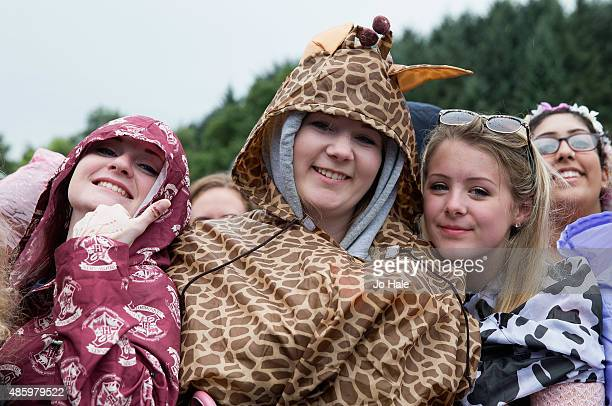 Fans during the rain at Fusion Festival at Cofton Park on August 30 2015 in Birmingham England