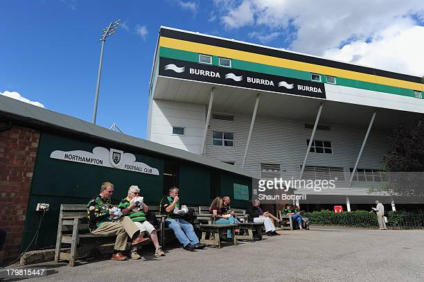 Fans eat outside 'The Crocked Hooker' before the Aviva Premiership match between Northampton Saints and Exeter Chiefs at Franklin's Gardens on...
