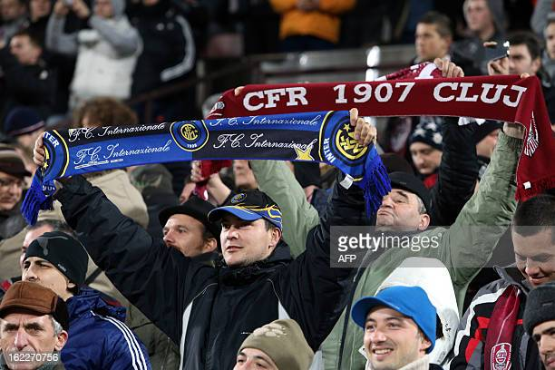 Fans encourage their favorites during the UEFA Europa League Round of 32 football match CFR 1907 Cluj vs Inter Milan in Cluj northern Romania on...