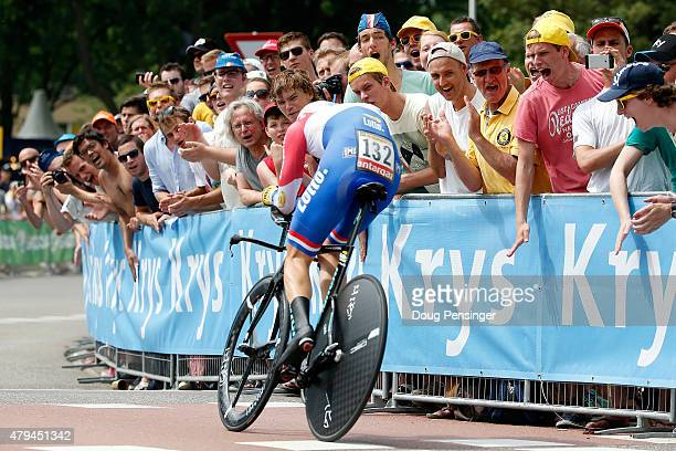Fans encourage Wilco Kelderman of the Netherlands racing for LottoNL-Jumbo as he races to ninth place in the individual time trial during stage one...