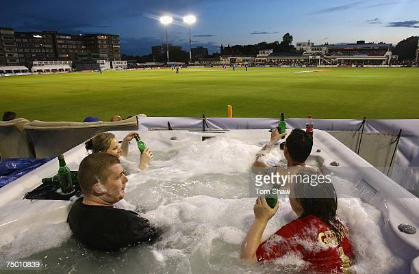 Fans enjoy a jacuzzi during the Twenty20 Cup match between Sussex and Essex at the County Ground on July 3, 2007 in Hove, England