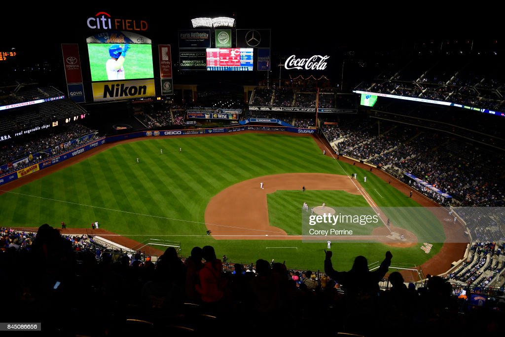 Fans enjoy a pitching change as the New York Mets host the Cincinnati Reds during the seventh inning at Citi Field on September 9, 2017 in the Flushing neighborhood of the Queens borough of New York City. The Mets won 6-1.
