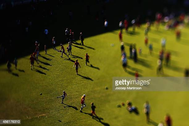 Fans enjoy activities while watching the 2014 AFL Grand Final at the MCG from the Sydney Swans Live Site at Sydney Cricket Ground on September 27...