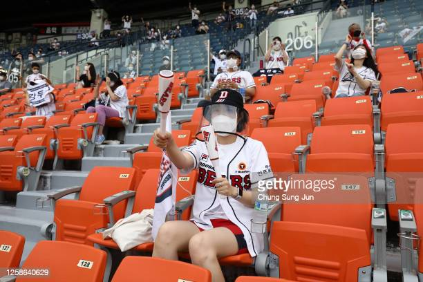 Fans enjoy during the KBO League game between LG Twins and Doosan Bears at the Jamsil Stadium on July 26, 2020 in Seoul, South Korea. South Korean...