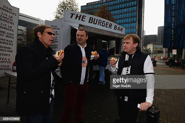Fans enjoy food from a street vendor ahead of the Barclays Premier League match between Newcastle United and Queens Park Rangers at St James' Park on...