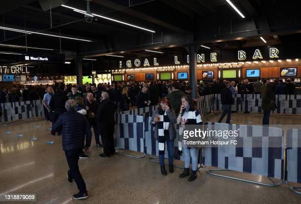Fans enjoy pre match food and drink inside the stadium concourse prior to the Premier League match between Tottenham Hotspur and Aston Villa at...