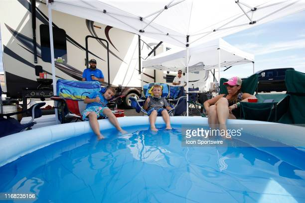 Fans enjoy race day with and inflatable pool during qualifying for the South Point 400 Monster Energy NASCAR Cup Playoff Series race on September 14...