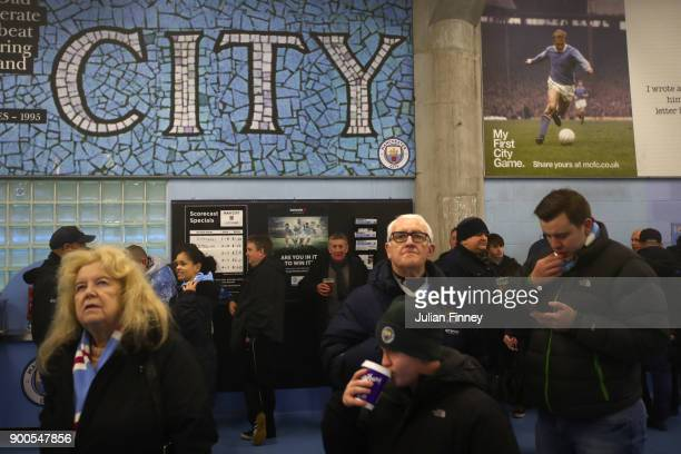 Fans enjoy some pre match food prior to the Premier League match between Manchester City and Watford at Etihad Stadium on January 2 2018 in...