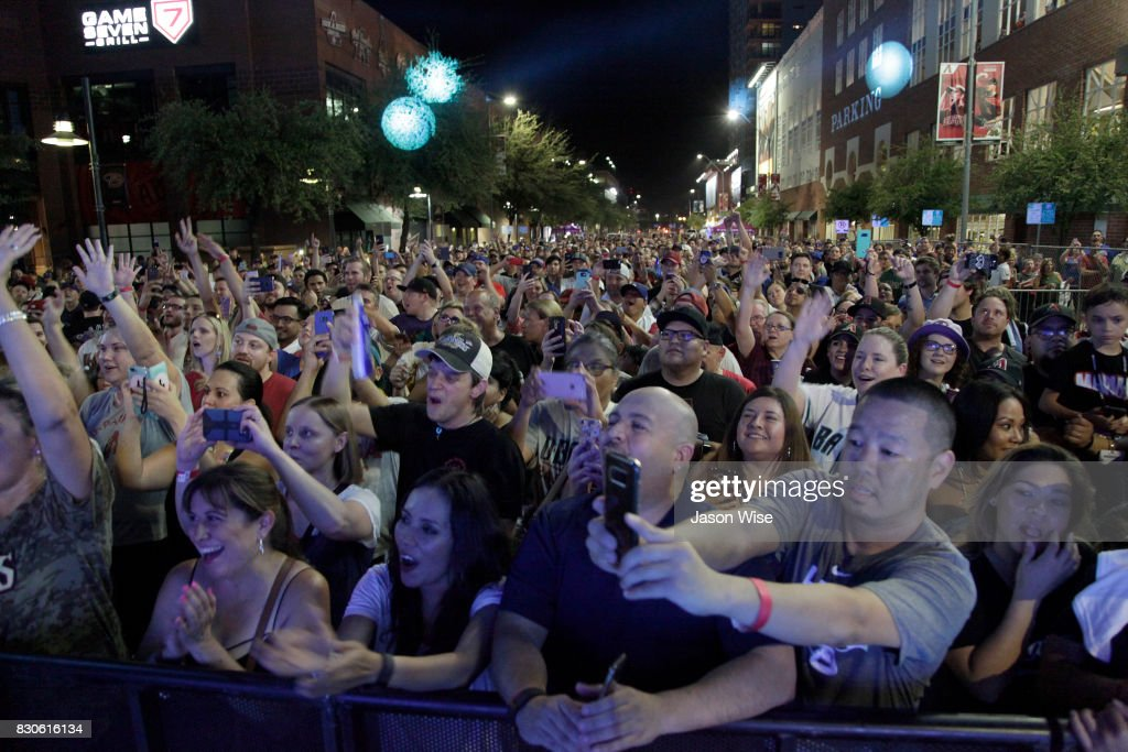 Fans enjoy Sugar Ray's Mark McGrath performaing at Chase Field on August 11, 2017 in Phoenix, Arizona.