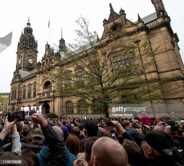 Fans enjoy the atmopshere as Sheffield United players parade through the streets of Sheffield after finishing second in the Sky Bet Championship to...