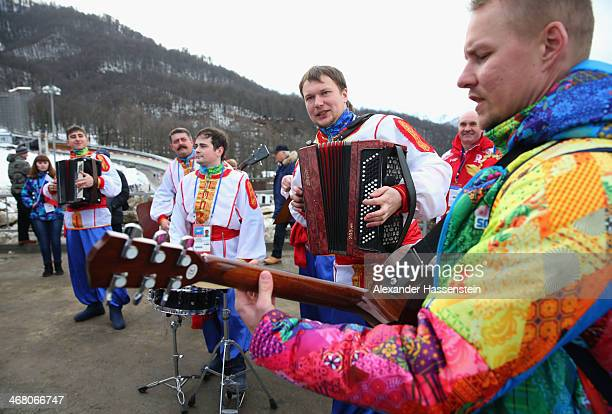 Fans enjoy the atmosphere ahead of the Men's Luge Singles on Day 2 of the Sochi 2014 Winter Olympics at Sliding Center Sanki on February 9, 2014 in...