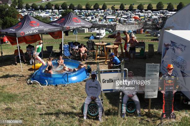 Fans enjoy the atmosphere around the circuit after qualifying for the F1 Grand Prix of Austria at Red Bull Ring on June 29 2019 in Spielberg Austria