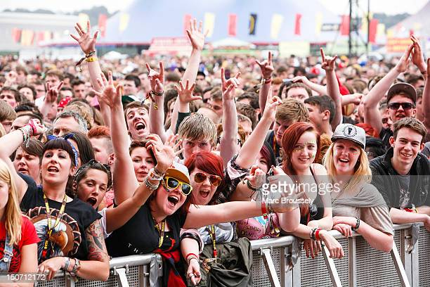 Fans enjoy the atmosphere as Angels And Airwaves perform on the main stage during day 1 of Reading Festival at Richfield Avenue on August 24 2012 in...