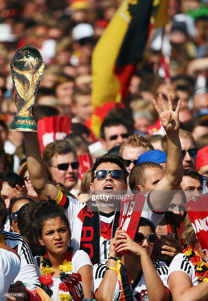 Fans enjoy the atmosphere as they wait for the players during the German team victory ceremony on July 15, 2014 in Berlin, Germany. Germany won the 2014 FIFA World Cup Brazil match against Argentina in Rio de Janeiro on July 13.