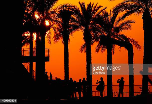 Fans enjoy the atmosphere at sunset during practice ahead of the Abu Dhabi Formula One Grand Prix at Yas Marina Circuit on November 21, 2014 in Abu...