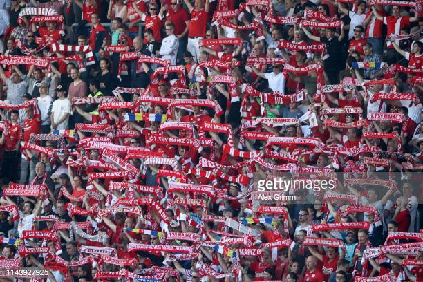 Fans enjoy the atmosphere during the Bundesliga match between 1. FSV Mainz 05 and Fortuna Duesseldorf at Opel Arena on April 20, 2019 in Mainz,...