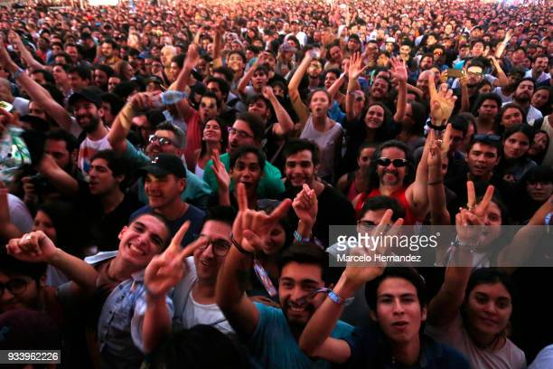 Fans enjoy the atmosphere during the first day of Lollapalooza Chile 2018 at Parque O'Higgins on March 16 2018 in Santiago Chile
