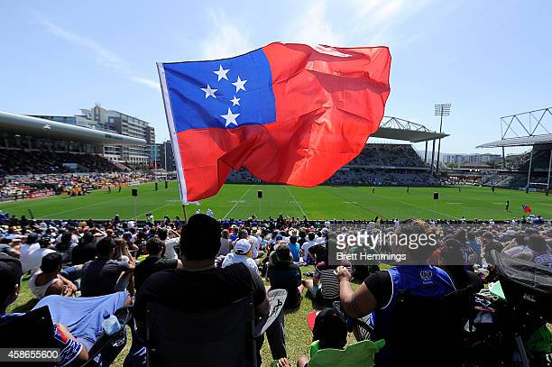 Fans enjoy the atmosphere during the Four Nations match between the Australian Kangaroos and Samoa at WIN Stadium on November 9 2014 in Wollongong...