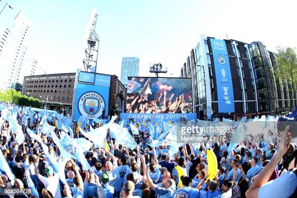 Fans enjoy the atmosphere during the Manchester City Trophy Parade on May 14 2018 in Manchester England