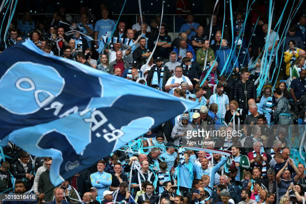 Fans enjoy the atmosphere during the Premier League match between Manchester City and Huddersfield Town at Etihad Stadium on August 19 2018 in...