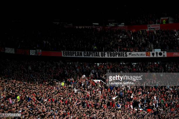 Fans enjoy the atmosphere during the Premier League match between Manchester United and Liverpool FC at Old Trafford on February 24 2019 in...