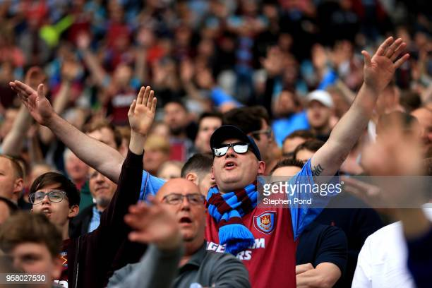 Fans enjoy the atmosphere during the Premier League match between West Ham United and Everton at London Stadium on May 13 2018 in London England