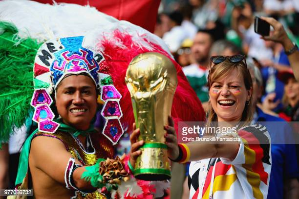 Fans enjoy the atmosphere in the ground before the 2018 FIFA World Cup Russia group F match between Germany and Mexico at Luzhniki Stadium on June 17...