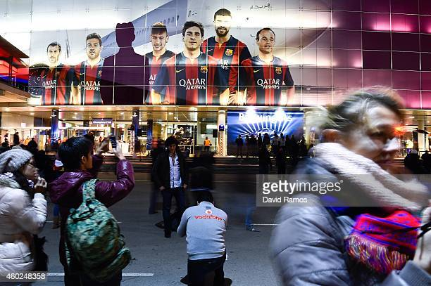 Fans enjoy the atmosphere prior to the UEFA Champions League group F match between FC Barcelona and Paris SaintGermanin FC at Camp Nou Stadium on...