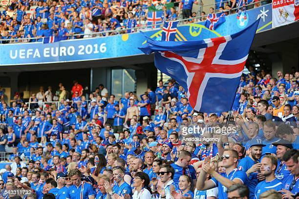 Fans enjoy the atmosphere prior to the UEFA Euro 2016 Round of 16 football match between Iceland and England at Stade de Nice in Nice, France on June...